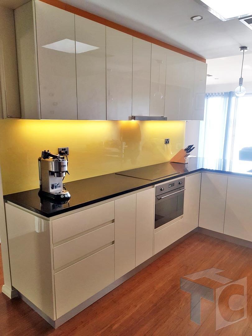 kitchen-cooking-appliances-yellow-backsplash